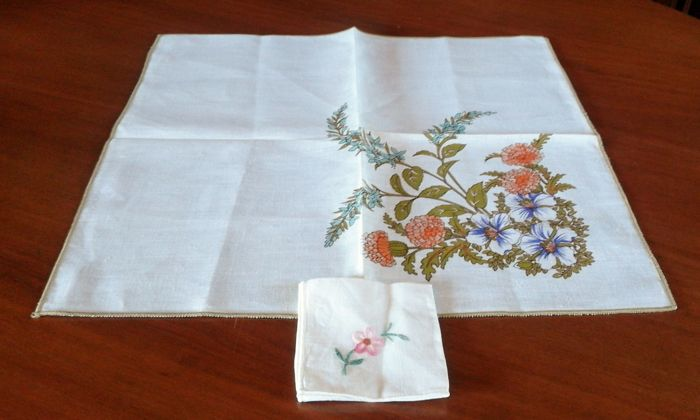 Two linen towels with stem stitch embroidered rims - with a napkin