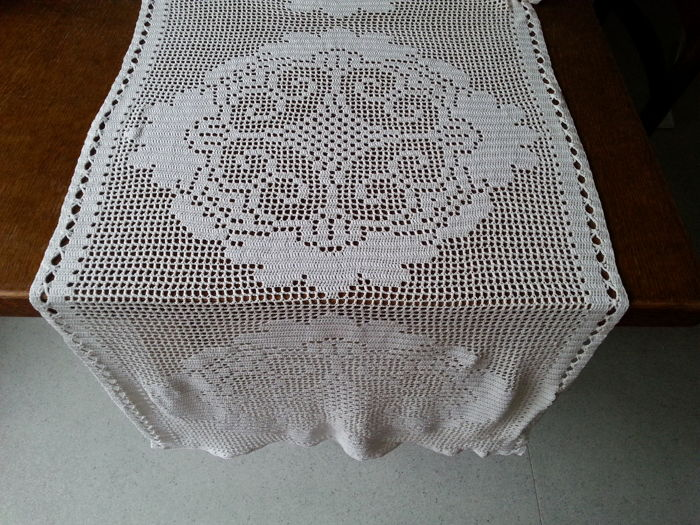 Very beautiful, long hand embroidered tablecloth.