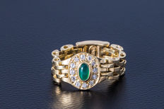Chain ring made of 585 yellow gold with an emerald (oval cabochon) and 12 diamonds (brilliant cut) approx. 0.15 ct