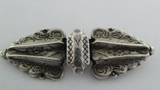Silver old brooch made of a bible clasp.