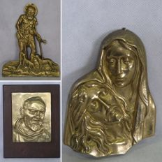 Lot of three sacred images in brass: Padre Pio, Madonna with Christ, Saint with crutches and dogs (Saint Anthony?)