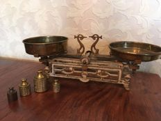 French scales with copper dishes and Dutch weights