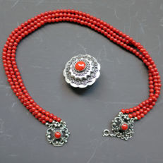 Set of an antique red coral necklace with double silver clasp and an antique silver brooch with red coral