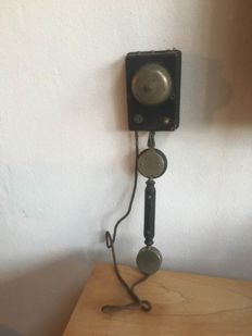 Antique wall telephone dating back to the 1930s