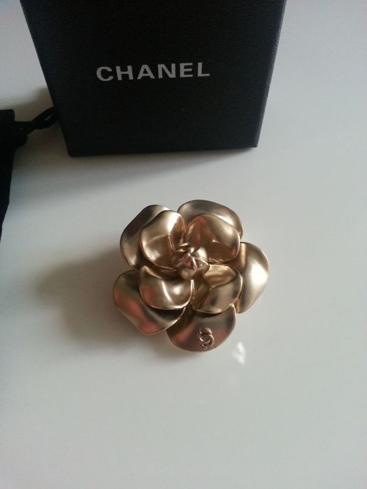 Chanel - camellia brooch with original box and dust bag