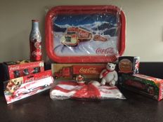 Beautiful Coca-Cola Christmas package with 10 items from years (1990s)