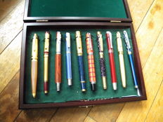 Ten superb collector fountain pens with iridium nibs Germany in an elegant box out of solid wood. Mid-20th century.