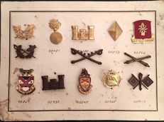 United States, 40s, World War II. Lot of 13 Original Emblems of Different Military Weapons from the American Army, US Army