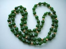 Long vintage necklace of genuine Jade beads in dark spinach green colour and 14K real Gold beads, 1950's