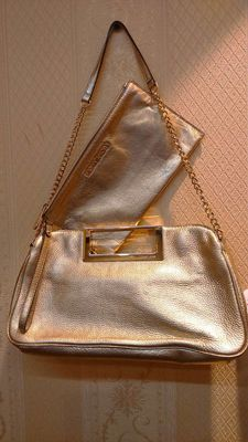 Michael Kors - Combined lot made up of a shoulder bag and purse