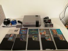 Nintendo NES With 6 Games, like Mario Bros, Turtles and more! including the manuals and dust protectors.