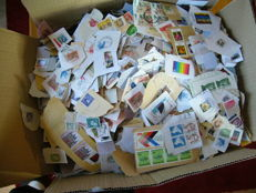 World - at elast 9 kg non-soaked stamps in a box