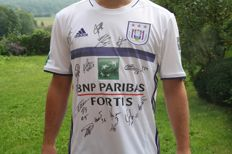 Original game soccer shirt from Belgian national soccer champion FC Anderlecht (season 2015-2016), with the name of Olivier Deschacht and signed by most players of the team (Teodorczyk, Appiah, Spajic, Chipciu, Boeckx, Thelin, Obradovic, Trebel, Hanni, Najar, Sowah, Kums, Dendoncker, Deschacht, Stanciu, Gerkens, Mbodji)