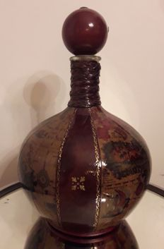 Old bottle decanter in the shape of a globe in leather and wood