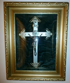 Crucifix plaque behind curved glass