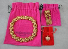 Yves Saint Laurent - set in gilded metal with champagne brooch