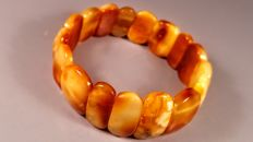 100% Genuine egg yolk colour Baltic Amber bracelet,  weight 21 gram
