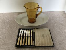 6 Silver plated fruit knives in case, glass decanter and earthenware dish England in the early 20th century