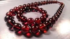 Round Cherry colour beads modified Baltic Amber necklace and bracelet. Necklace length 56 cm, bracelet hole ca. 58 mm