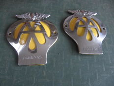 Two English AA roadside assistance emblems from the 1960s.