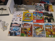 Nintendo WII set including 10 games like: Mario bros , Paper Mario and more