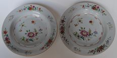 2 porridge plates with famille rose decoration - China - 18th century