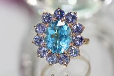 18 kt gold entourage ring set with topaz and tanzanites, size: 53