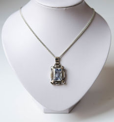 Large silver pendant with light-blue stone on chain
