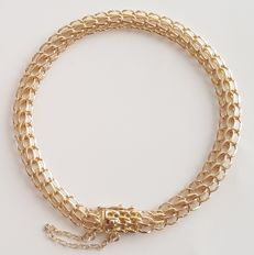 18 kt yellow gold flexible bracelet - Length: 18 cm - Weight: 14.2 g