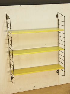 A. Dekker for Tomado - book rack/wall rack for pocketbooks in the authentic colours.