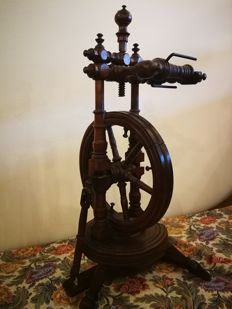 Wooden spinning wheel, working tool