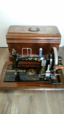 Beautifully decorated sewing machine Clemens Muller in an attractive wooden case