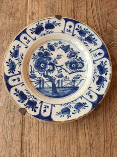 Two faience/Delft earthenware plates