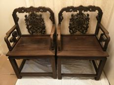 Pair of chairs in exotic wood carved with bats - China - late 20th century