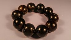 Black colour modified round beads Baltic Amber bracelet. Hole ca. 50 mm, 47 grams