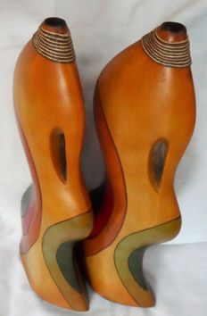 A pair of magnificent hand-carved wooden vases from Africa 59 cm in height