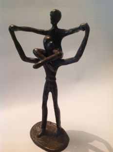 Father with child on shoulders bronze sculpture ca 1960 Burkina Fasso