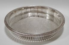 A silver plated open work serving tray with floral engravings