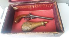 Wooden box with double barrel pinfire pistol with powder horn Dixson & Sons