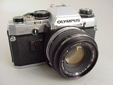 Single-lens reflex Olympus OM-10 with Olympus lens Auto-S  1 : 1.8 f = 50mm and National PE-280C flash
