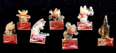 A collection of Seven , vintage , Coca Cola , advertising pins , made in 1980´s for Olympic Games Barcelona 1992