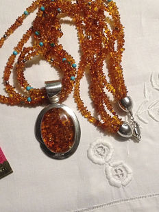 Necklace with four strings of amber, 925 silver beads and turquoise with medallion