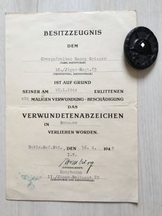 Wounded badge for the army in black and ownership certificate corresponding to the wounded badge in black, 1941