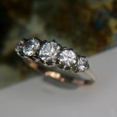 ca. 1920/1930 original Antique golden ring or mariage ring with 5 white Sapphires ca. 0,83Ct. on a bridge set in silver. Wonderful state.