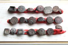 Medieval bronze shields from rings - 12 - 18mm (18)