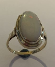 Gold ring with a milky opal, the Netherlands c. 1960, by Schijfsma in Sneek