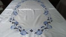 A beautiful old, white tablecloth with machine-made embroidery