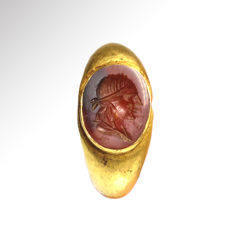 Roman Gold and Cornelian Intaglio Ring, engraved with bust of bearded man in toga, 1.8 cm inside D /  total weight 4.7grms