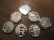 World - shipping - 1992 / 2003- 6 silver 1 ounce coins and 1 coin of 28 grams, Andorra, Latvia, Cuba, Guinea-Bissau, Great Britain.