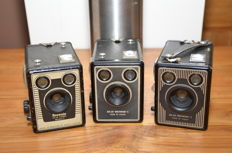 Three Kodak Brownie box cameras from the 1940s/1950s, the six-20 Brownie E and both models of the six-20 Brownie C. Working with 620 roll film